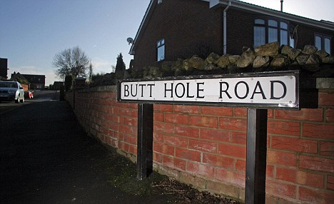 The street sign for Butt Hole Road